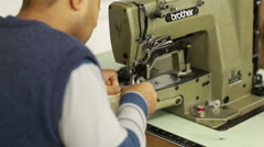 Working in textile industry at a sweater - stock footage