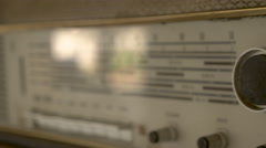 Cinematic 4k vintage radio highlighting the tuning and treble knobs - stock footage
