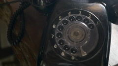 Old black rotary phone dolly shot in 4k with a ceiling fan reflection Stock Footage