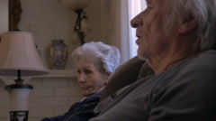 An aging mother listens closely to her elder son talking Stock Footage