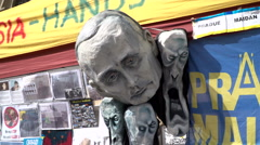 An Ukraine support spot in Prague with a head of Putin and a 3 demons. Stock Footage