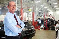 Mature Car dealer man. - stock photo