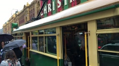 MELBOURNE – NOVEMBER 2015: View of people in the vintage green and yellow tram Stock Footage