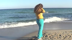 Woman on beach Stock Footage