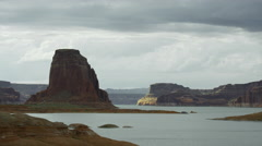 Wide shot of jet boat winding through remote river / Lake Powell, Utah, United Stock Footage