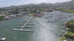 Slow aerial pan of port and town in St Lucia Stock Footage
