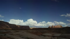 Wide time lapse shot of clouds passing over desert landscape / Lake Powell, Stock Footage
