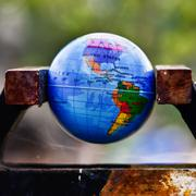 world globe in a vise - stock photo