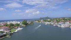 Boat leaving marina - St Lucia Stock Footage