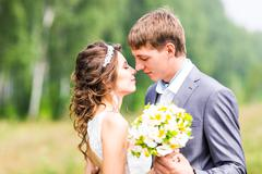 Young wedding couple, beautiful bride with groom portrait, summer nature outdoor Stock Photos