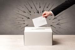 Stock Photo of close up of a ballot box and casting vote