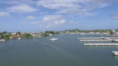 Boat heading towards marina in Rodney bay - St Lucia Stock Footage