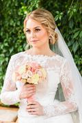 Nice wedding bouquet in bride's hand Stock Photos