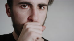 A Young Handsome Man With A Beard Looks Into The Camera And Coughing - stock footage