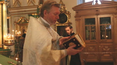 the priest in the Church a prayer in St. Nicholas Cathedral - stock footage
