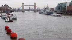 Tourist boat heads towards Tower Bridge Stock Footage