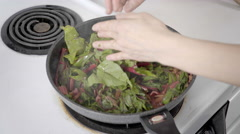 Vegetarian cooking. Swiss Chard in frying pan. Stock Footage