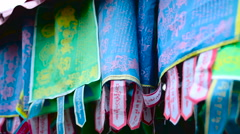 Colourful flags with Buddhist mantras Stock Footage