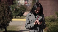 Young girl work with smartphone Stock Footage