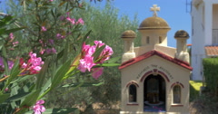 Greek Memorial Chapel Kandylakia and Blooming Trees Stock Footage