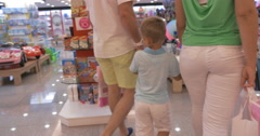 Family walking in toy shop Stock Footage