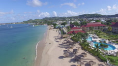 Aerial of resort and coast line - St Lucia Stock Footage