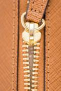 Zipper Closeup On Brown Leather Wallet Stock Photos
