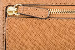 Zipper Closeup On Brown Leather Wallet - stock photo