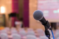 Microphone in meeting room before a conference Stock Photos