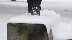 Woman legs with warm high boots walk on wooden path covered with snow. 4K Stock Footage
