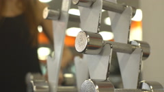 Gym woman strength training lifting dumbbell Stock Footage