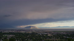 Wide shot of storm clouds over cityscape and mountain / Cedar Hills, Utah, Stock Footage