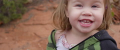 Slow Motion Little Girl Smiles and Flings Her Hair Around Stock Footage