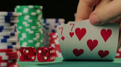 Risky poker player catches pocket pair, gambler hopes to win fortune in casino - stock footage