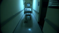 Empty gurney with bloody sheets in hospital hallway HD Video Stock Footage