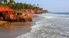 Tropical beach scenery with red cliffs Stock Footage