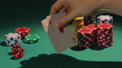 Lucky poker player showing good cards to rivals, winner in casino tournament Stock Footage