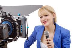 portrait of elegant blonde woman TV reporter - stock photo