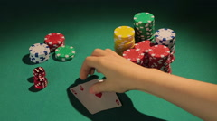 Poker player showing pair of aces, good chance to win big bank from rivals Stock Footage