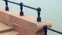Stock Video Footage of Close up view at granite Volga river embankment and water surface, Astrakhan