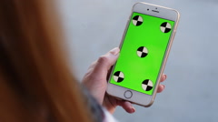 Stock Video Footage of Smart Phone held by woman hands. Green screen Chroma Key. Close up. Tracking