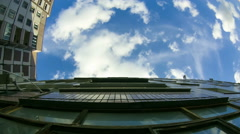 Clouds Moving over the Multistorey Buildings Time Lapse - stock footage