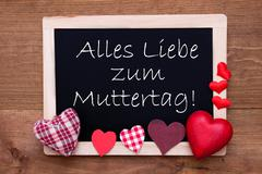 Blackboard With Textile Hearts, Text Muttertag Means Happy Mothers Day Stock Photos