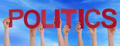 Many People Hands Holding Red Straight Word Politics Blue Sky - stock photo