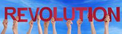 Many People Hands Holding Red Straight Word Revolution Blue Sky - stock photo