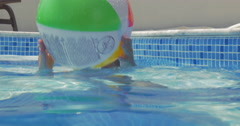 Little playful child with ball in pool - stock footage
