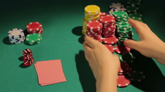 Reckless gambler betting all chips in poker game, wants to win big money, casino - stock footage