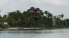 View to the observation towers at the Palawan beach at Sentosa, Singapore. Stock Footage