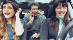 Beautiful people in car laughing driving happy 4K - stock footage