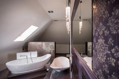 Comfortable freestanding bath Stock Photos